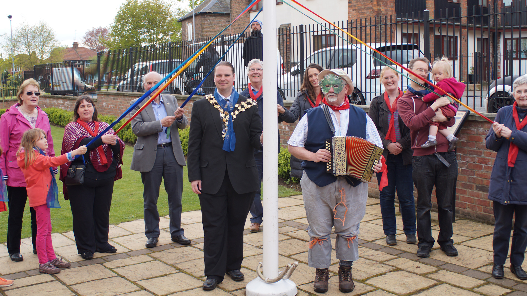 Round the pole -- Wisbech mayor Councillor Garry Tibbs and green man and accordionist Keith Aplin join revellers to mark the start of May