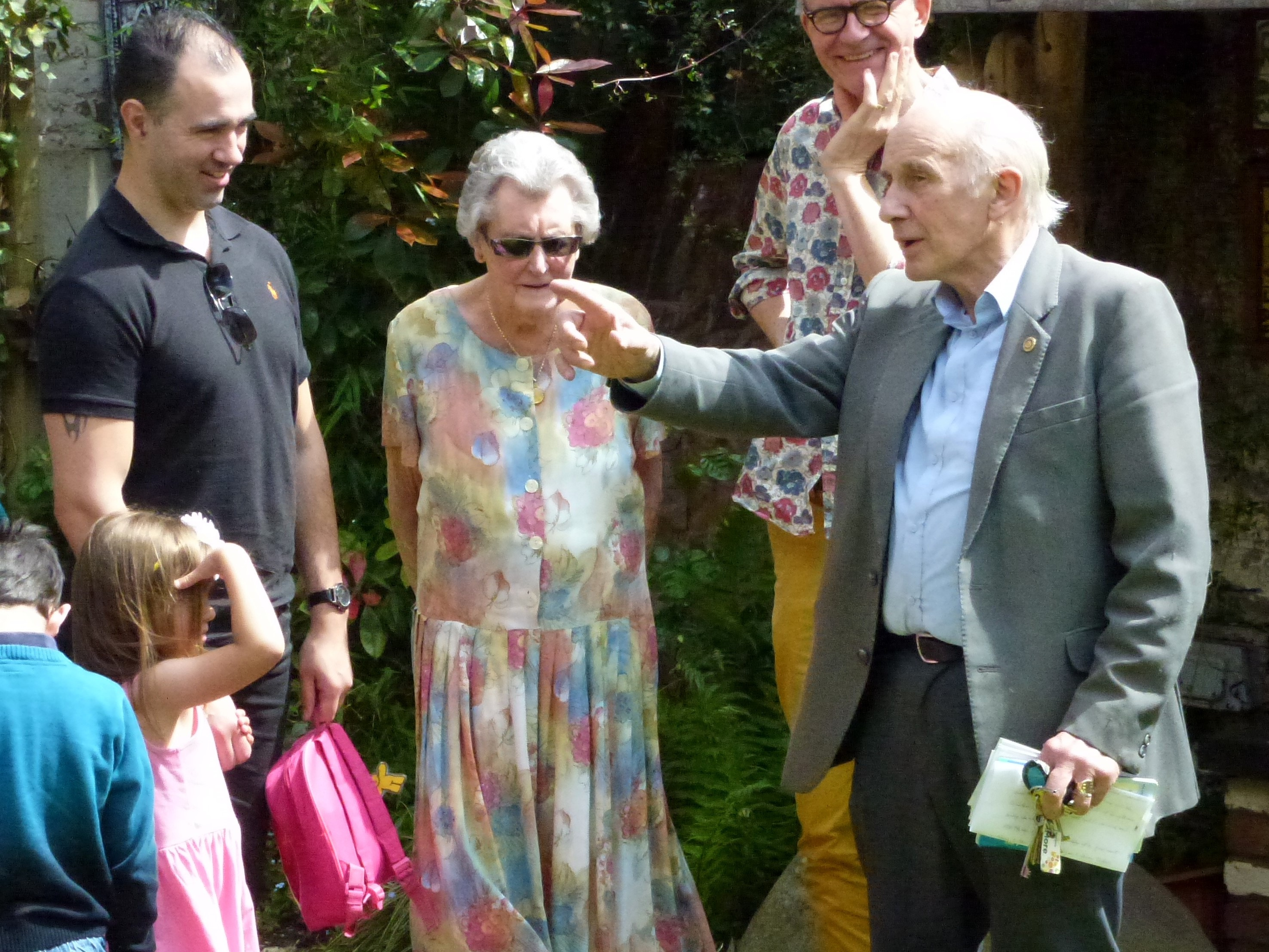 Peter Clayton (right) with Mrs Betty Burgess, the widow of Norman Burgess, (centre) and family members at Heroes' Arcade