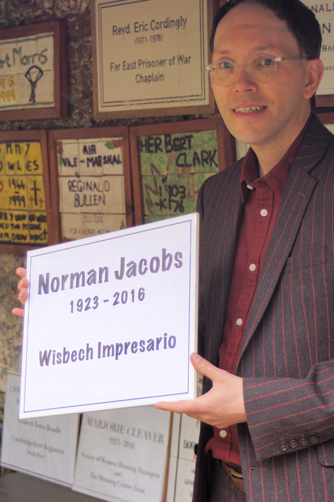 Norman Jacobs Jnr with the plaque to his father