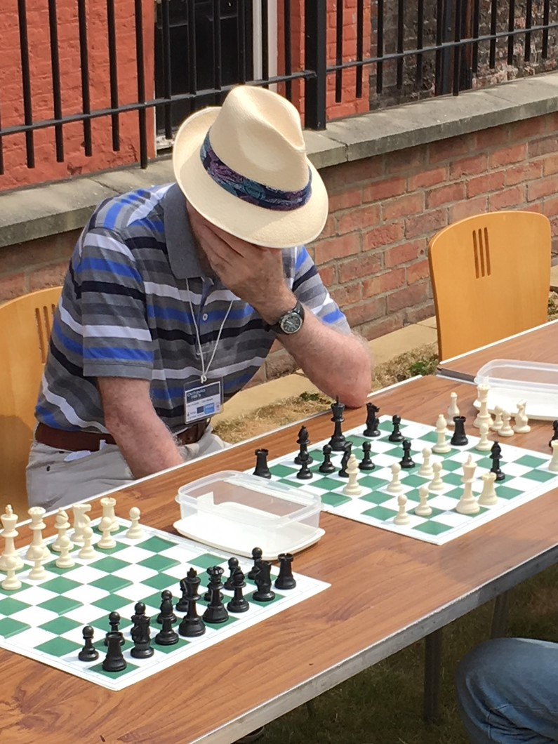 Down to size - a game of normal-sized chess on the upper green