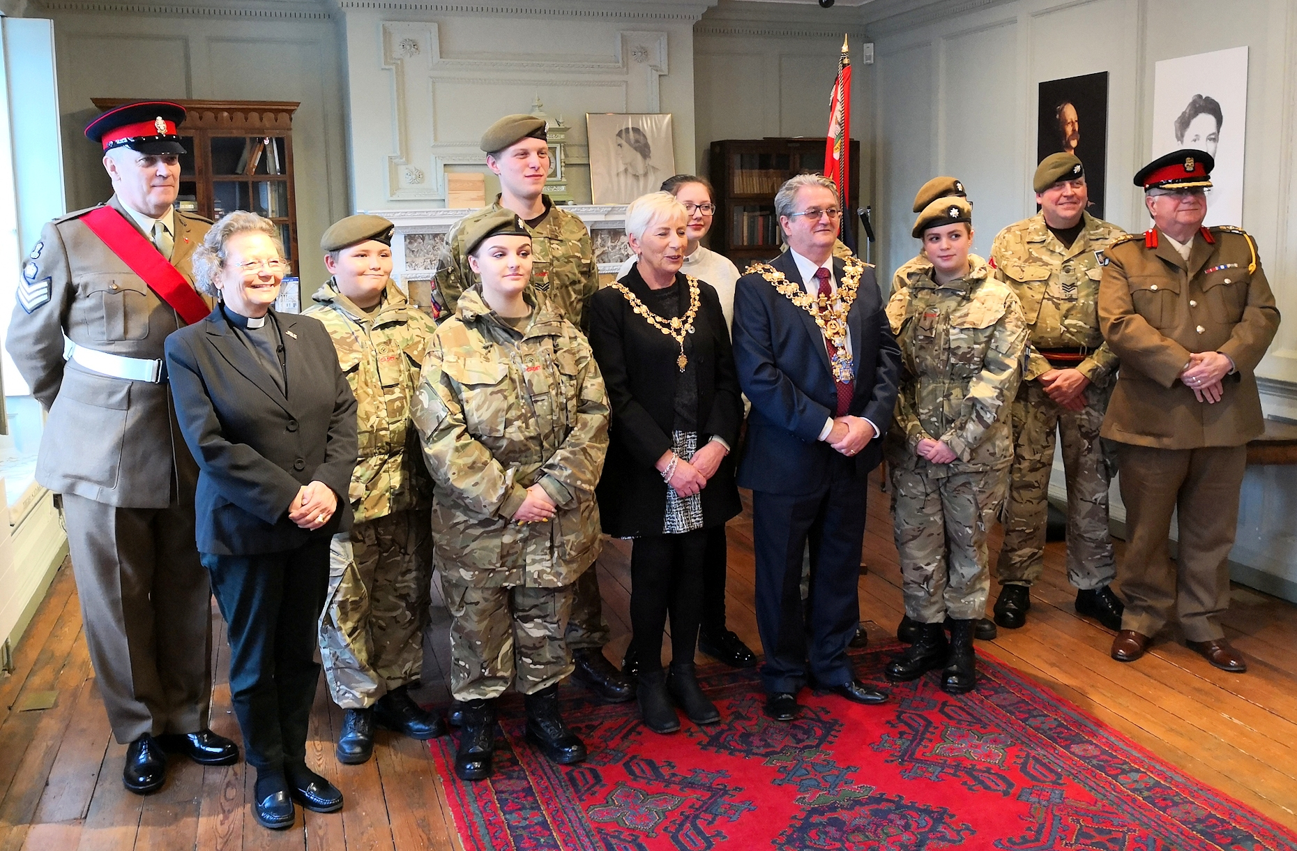 Colonel Mark Knight (right), Colour Sergeant Tim Scargill (left), the Rev Carol Monk (second left) and Wisbech mayor Councillor Peter Human (centre) with members of the Wisbech detachment of the Cambridgeshire army cadet force in the Long Room at the Birthplace House