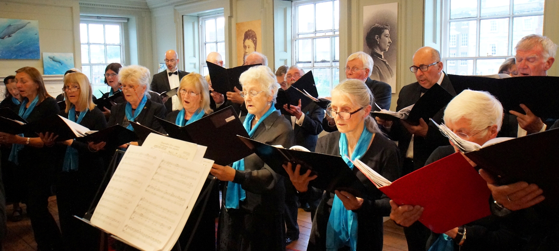 The choir in full voice in the Long Room